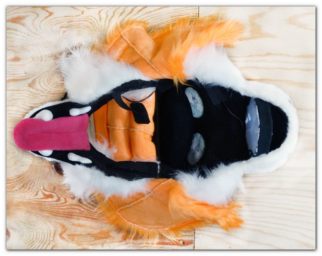 "Mask of fursuit in the ""open"" position"